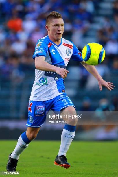Alejandro Chumacero of Puebla drives the ball during the 8th round match between Cruz Azul and Puebla as part of the Torneo Clausura 2018 Liga MX at...