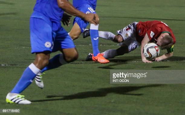 Alejandro Chumacero of the Bolivian National Football Team falls in the grass during a friendly match against Nicaragua at the National Stadium in...