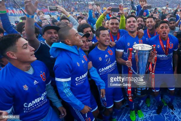 Alejandro Contreras of Universidad de Chile and teammates celebrates with the championship cup after winning a match between Universidad de Chile v...