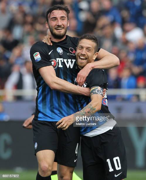 Alejandro Dario Gomez of Atalanta BC celebrates with his teammate Bryan Cristante after scoring the opening goal during the Serie A match between...