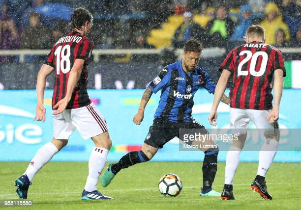 Alejandro Dario Gomez of Atalanta BC competes for the ball with Ignazio Abate and Riccardo Montolivo of AC Milan during the serie A match between...