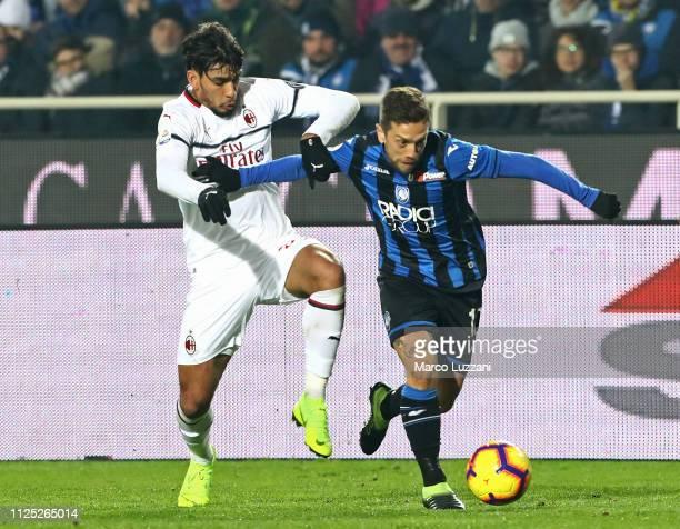 Alejandro Dario Gomez of Atalanta BC competes for the ball with Lucas Paqueta of AC Milan during the Serie A match between Atalanta BC and AC Milan...