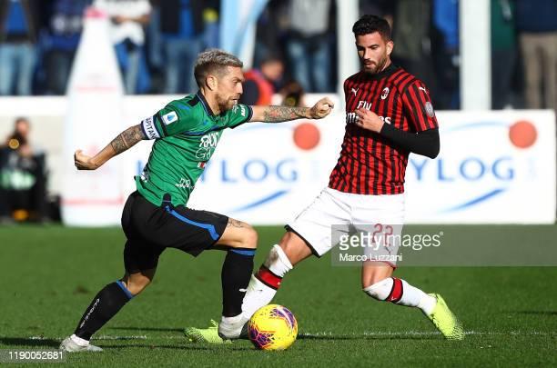 Alejandro Dario Gomez of Atalanta BC competes for the ball with Mateo Musacchio of AC Milan during the Serie A match between Atalanta BC and AC Milan...
