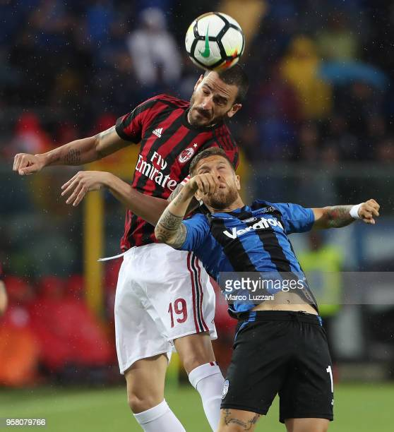 Alejandro Dario Gomez of Atalanta BC competes for the ball with Leonardo Bonucci of AC Milan during the serie A match between Atalanta BC and AC...
