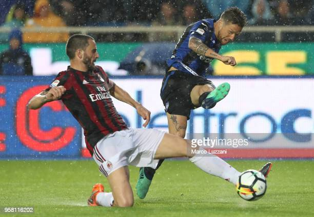 Alejandro Dario Gomez of Atalanta BC is challenged by Leonardo Bonucci of AC Milan during the serie A match between Atalanta BC and AC Milan at...