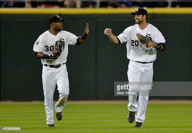 Alejandro De Aza and Jordan Danks of the Chicago White Sox celebrate their win over the Toronto Blue Jays at US Cellular Field on August 15 2014 in...