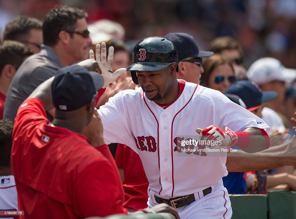 Alejandro De Aza #31 of the Boston Red Sox is congratulated after hitting a three-run home run during the fourth inning against the Baltimore Orioles at Fenway Park in Boston, Massachusetts on June 25, 2015.