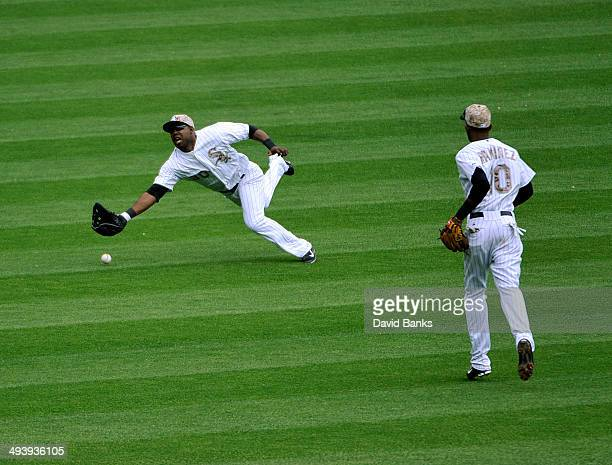 Alejandro De Aza of the Chicago White Sox can't make catch on a single by Michael Brantley of the Cleveland Indians on May 26 2014 at US Cellular...