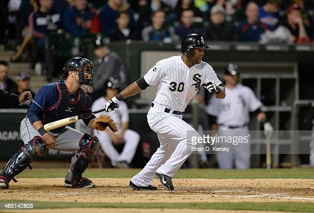 Alejandro De Aza of the Chicago White Sox follows through on an RBI single scoring Adam Dunn during the fourth inning against the Cleveland Indians...
