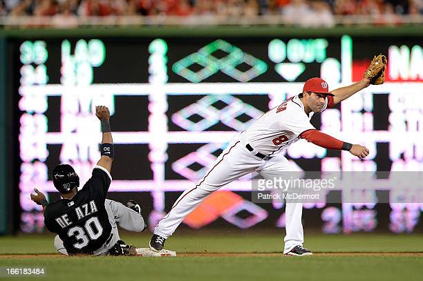 Alejandro De Aza of the Chicago White Sox is out at second base as Danny Espinosa of the Washington Nationals completes a double play in the fifth...