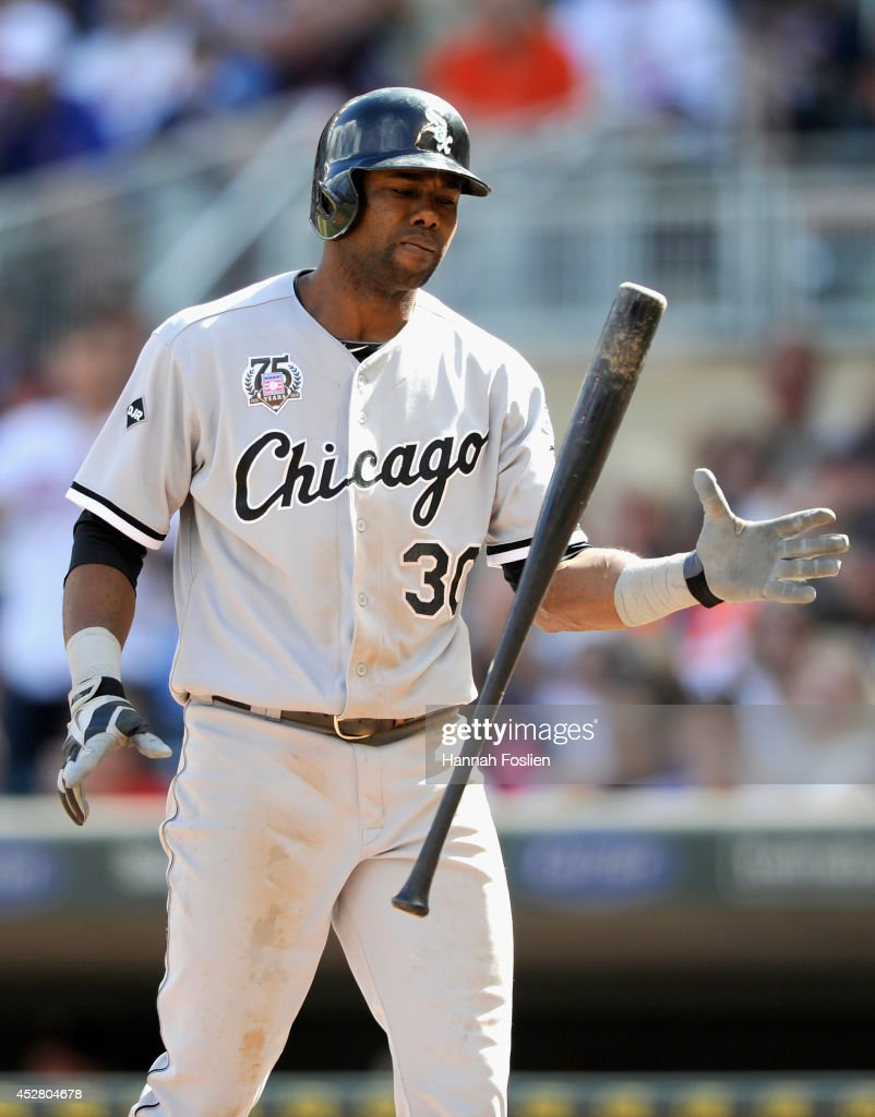 Alejandro De Aza #30 of the Chicago White Sox reacts to striking out against the Minnesota Twins with the bases loaded during the ninth inning of the game on July 27, 2014 at Target Field in Minneapolis, Minnesota. The Twins defeated the White Sox 4-3.