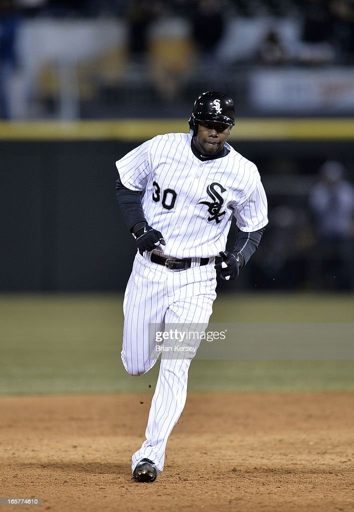 Alejandro De Aza #30 of the Chicago White Sox rounds the bases after hitting a two-run home run scoring teammate Tyler Flowers during the fifth inning against the Seattle Mariners on April 5, 2012 at U.S. Cellular Field in Chicago, Illinois.