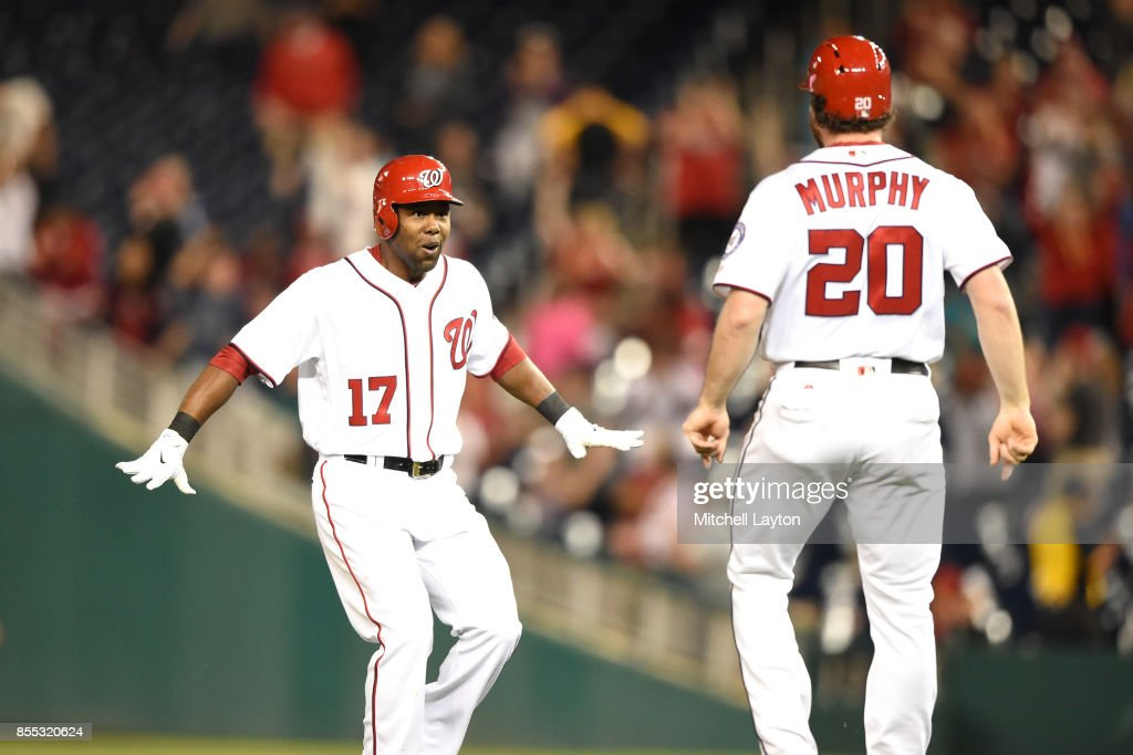 Alejandro De Aza #17 of the Washington Nationals celebrates getting a game-winning hit with Daniel Murphy #20 to score Anthony Rendon #6 during a baseball game against the Pittsburgh Pirates at Nationals Park on September 28, 2017 in Washington, DC.