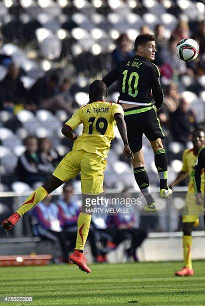 Alejandro Diaz of Mexico jumps for the ball with Adama Traore of Mali during FIFA's Under20 World Cup's football match between Mexico and Mali in...