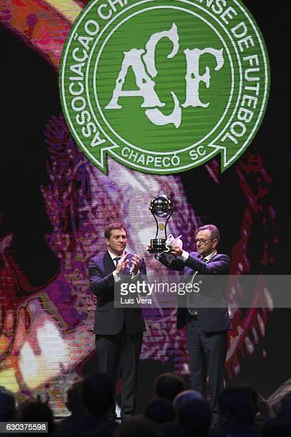 Alejandro Dominguez president of CONMEBOL claps as Plinio David de Nes president of Chapecoense raises the Copa Sudamericana Trophy during the during...