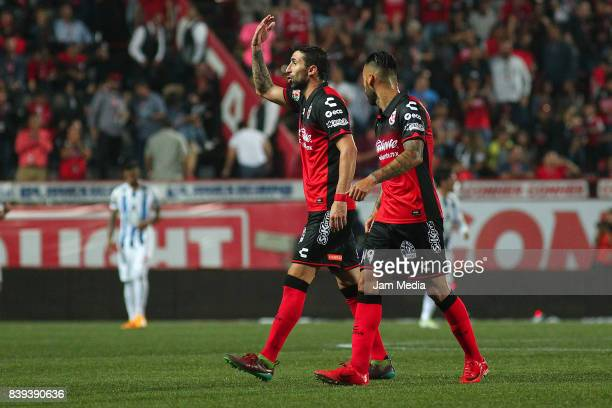 Alejandro Donatti and Victor Aguilera of Tijuana celebrate the first goal of his team scored by his teammate Gustavo Bou during the seventh round...