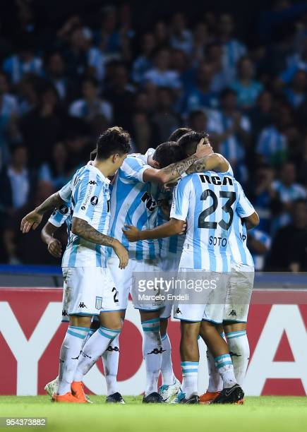 Alejandro Donatti of Racing Club celebrates with teammates after scoring the first goal of his team during a group stage match between Racing Club...