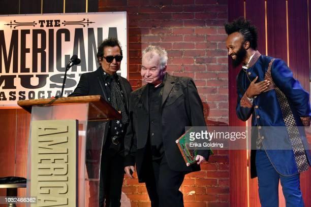 Alejandro Escovedo and Fantastic Negrito present an award to John Prine onstage during the 2018 Americana Music Honors and Awards at Ryman Auditorium...
