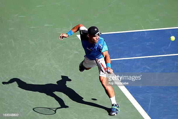 Alejandro Falla of Colombia plays a forehand in his match against Tomas Berdych of Czech Republic during day four of the Rakuten Open at Ariake...