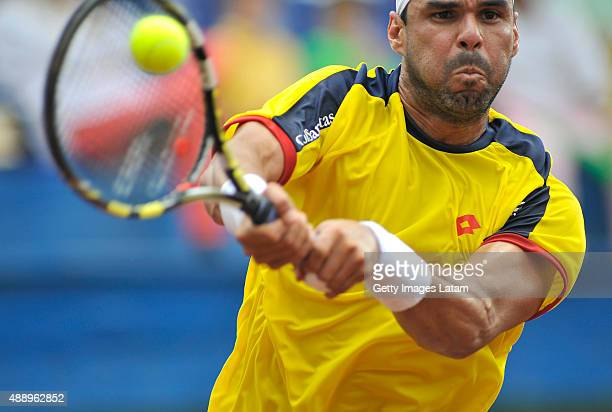 Alejandro Falla of Colombia returns a backhand shot during the Davis Cup World Group Playoff singles match between Alejandro Falla of Colombia and...