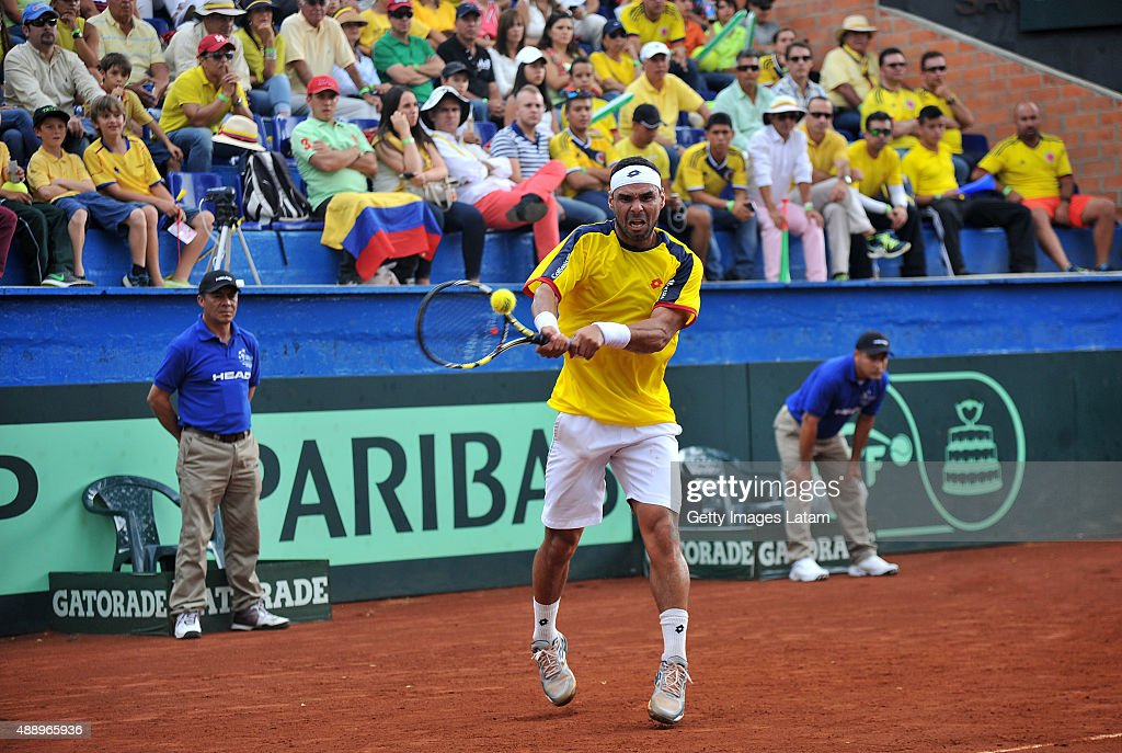Alejandro Falla of Colombia returns a backhand shot during the Davis Cup World Group Play-off singles match between Alejandro Falla of Colombia and Kei Nishikori of Japan at Club Campestre on September 18, 2015 in Pereira, Colombia.