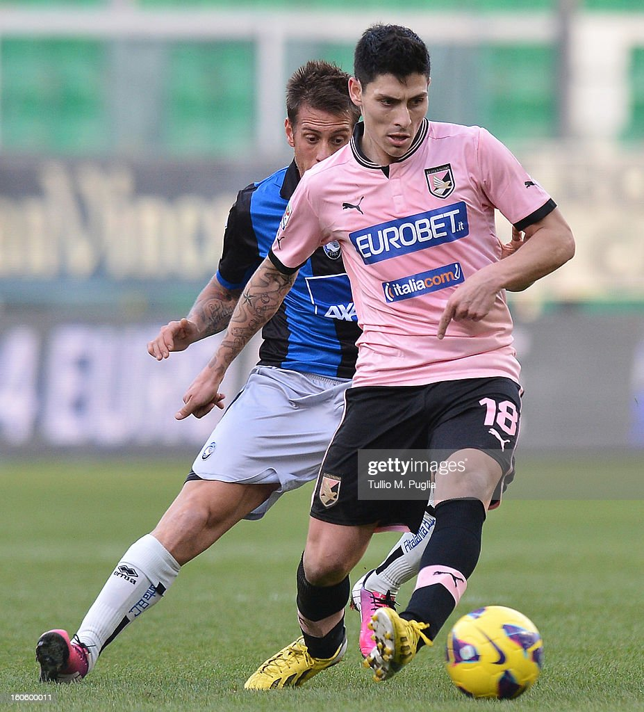 Alejandro Faurlin (R) of Palermo and German Denis of Atalanta compete for the ball during the Serie A match between US Citta di Palermo and Atalanta BC at Stadio Renzo Barbera on February 3, 2013 in Palermo, Italy.