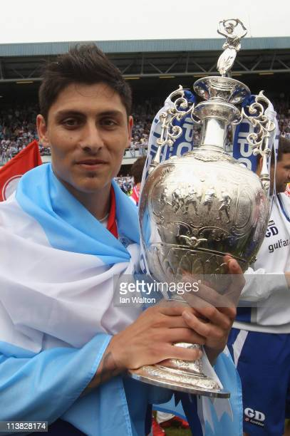 Alejandro Faurlin of QPR celebrates with the trophy after winning the npower Championship match between Queens Park Rangers and Leeds United at...