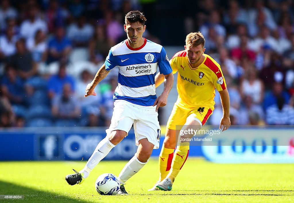 Alejandro Faurlin of QPR takes the ball past Lee Frecklington of Rotherham during the Sky Bet Championship match between Queens Park Rangers and Rotherham United at Loftus Road on August 22, 2015 in London, England.