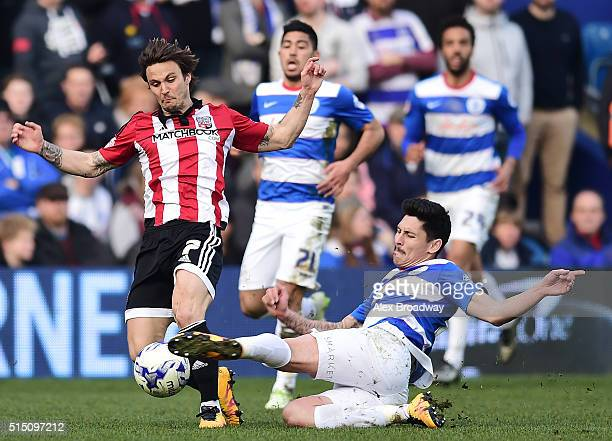 Alejandro Faurlin of Queens Park Rangers tackles Sam Saunders of Brentford during the Sky Bet Championship match between Queens Park Rangers and...