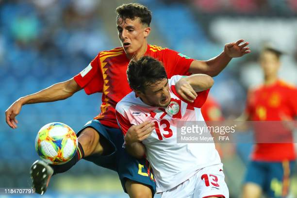 Alejandro Frances of Spain clears the ball around Amadoni Kamolov of Tajikistan during the FIFA U17 World Cup Brazil 2019 group E match between Spain...