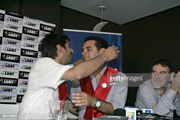 Alejandro Freyre and Jose Maria Di Bello embrace each other next to the president of the INADI actor Juan Morgado after offering a press conference...