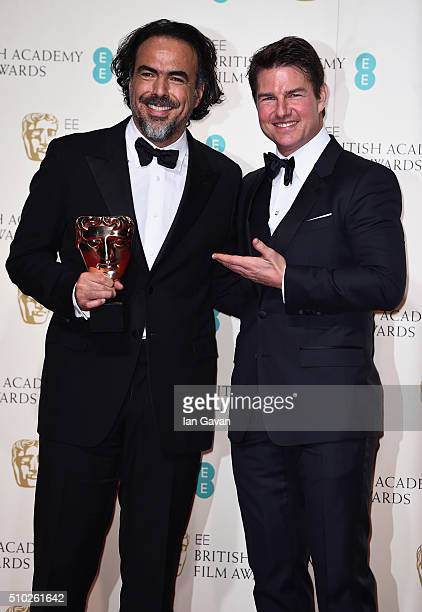 Alejandro G Iñárritu winner of Best Director for 'The Revenant' and Tom Cruise pose in the winners room at the EE British Academy Film Awards at the...