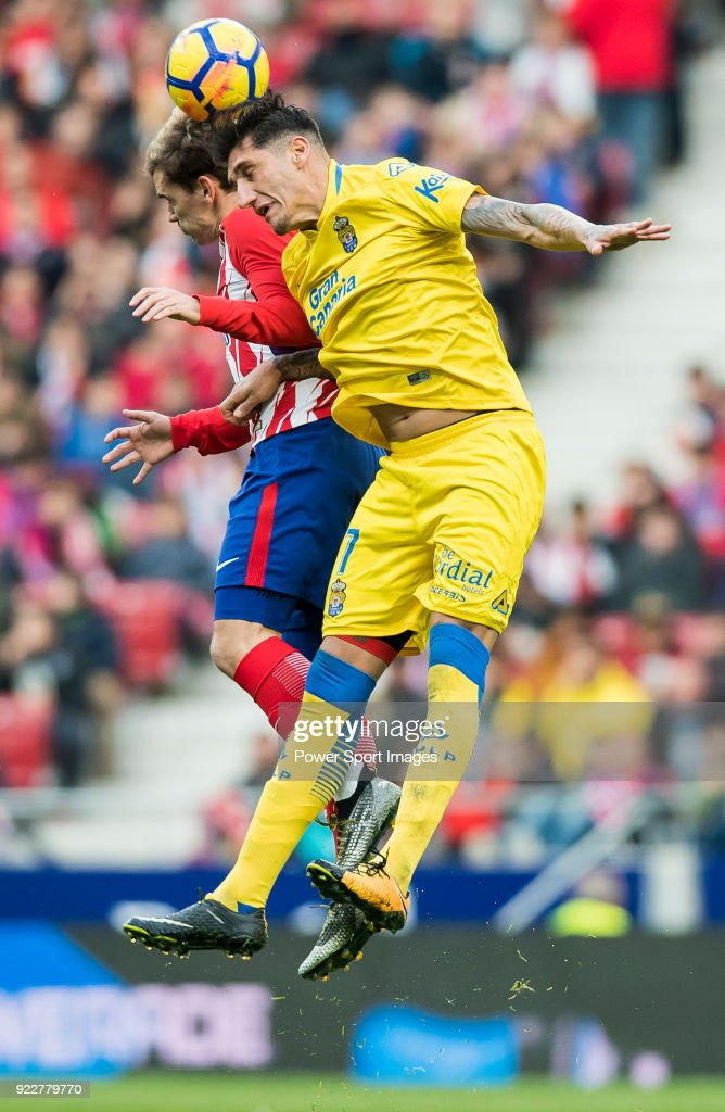Alejandro Galvez Jimena (R) of UD Las Palmas fights for the ball with Antoine Griezmann of Atletico de Madrid during the La Liga 2017-18 match between Atletico de Madrid and UD Las Palmas at Wanda Metropolitano on January 28 2018 in Madrid, Spain.