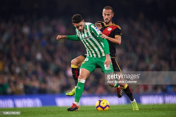 Alejandro Galvezof Rayo Vallecano competes for the ball with Antonio Barragan of Real Betis Balompie during the La Liga match between Real Betis...