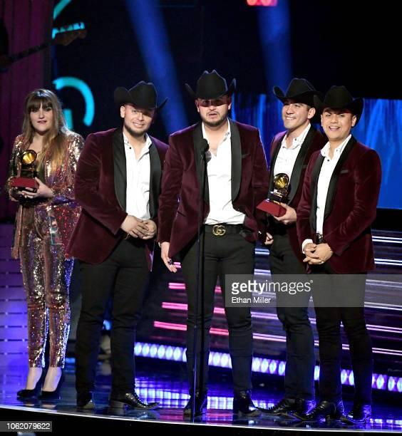 Alejandro Gaxiola Eden Munoz Armando Ramos and Erick Garcia of music group Calibre 50 accept the award for Best Norteno Album for 'Guerra de Poder'...