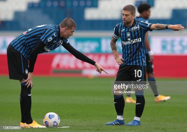 Alejandro Gomez and Josip Ilicic of Atalanta BC gesture during the Serie A match between Atalanta BC and UC Sampdoria at Gewiss Stadium on October...