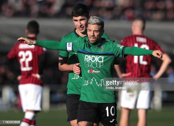 Alejandro Gomez and Ruslan Malinovskyi of Atalanta BC celebrates after their teammate Mario Pasalic scored during the Serie A match between Atalanta...