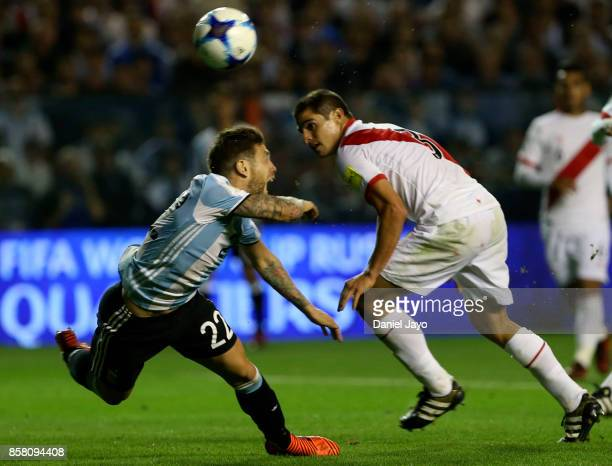 Alejandro Gomez of Argentina and Aldo Corzo of Peru go for a header during a match between Argentina and Peru as part of FIFA 2018 World Cup...