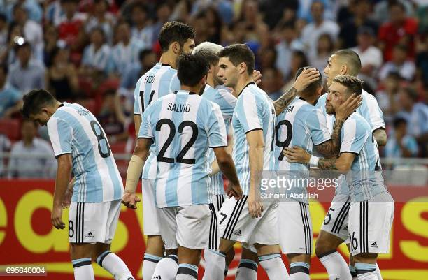 Alejandro Gomez of Argentina celebrates with teammates after scoring a goal during the International Test match between Argentina and Singapore at...