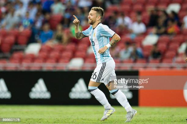 Alejandro Gomez of Argentina celebrating his goal with his teammates during the International Test match between Argentina and Singapore at National...