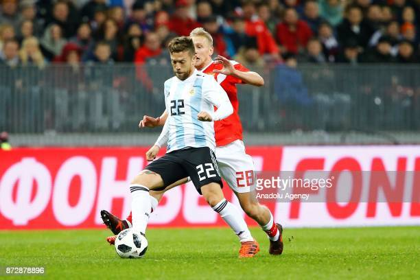 Alejandro Gomez of Argentina in action against Igor Smolnikov of Russia during the international friendly match between Russia and Argentina at BSA...