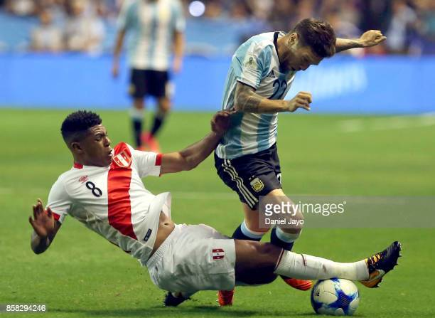 Alejandro Gomez of Argentina is tackled by Wilder Cartagena of Peru during a match between Argentina and Peru as part of FIFA 2018 World Cup...