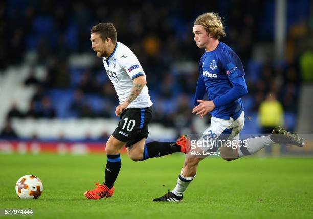 Alejandro Gomez of Atalanta and Tom Davies of Everton battle for possession during the UEFA Europa League group E match between Everton FC and...