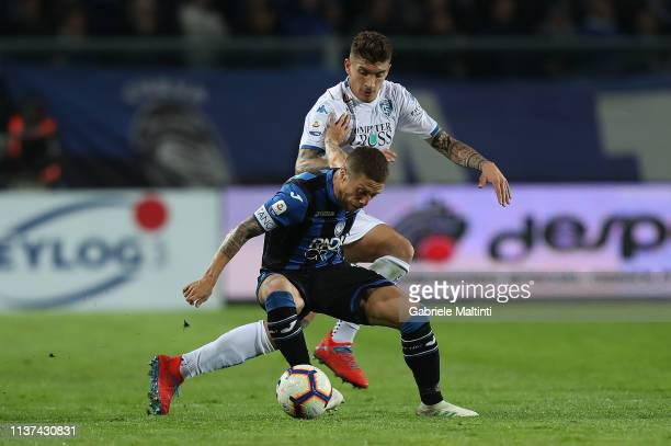 Alejandro Gomez of Atalanta Bc battles for the ball with Giovanni Di Lorenzo of Empoli FC during the Serie A match between Atalanta BC and Empoli at...