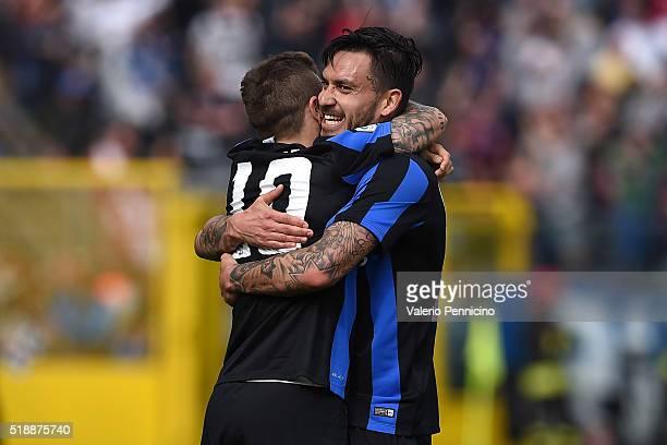 Alejandro Gomez of Atalanta BC celebrates a goal with team mate Mauricio Pinilla during the Serie A match between Atalanta BC and AC Milan at Stadio...