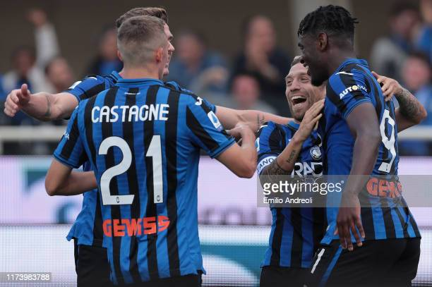 Alejandro Gomez of Atalanta BC celebrates his goal with his teammate Duvan Zapata Timothy Castagne and Hans Hateboer during the Serie A match between...
