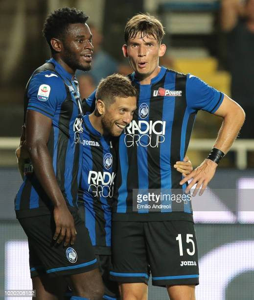 Alejandro Gomez of Atalanta BC celebrates his second goal with his teammates Duvan Zapata and Marten De Roon during the serie A match between...