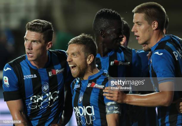 Alejandro Gomez of Atalanta BC celebrates with his teammates after scoring the opening goal during the serie A match between Atalanta BC and...