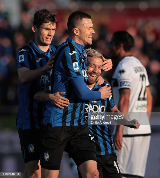 Alejandro Gomez of Atalanta BC celebrates with his team-mates Josip Ilicic and Marten De Roon after scoring the opening goal during the Serie A match...