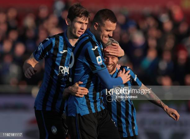 Alejandro Gomez of Atalanta BC celebrates with his teammates Josip Ilicic and Marten De Roon after scoring the opening goal during the Serie A match...